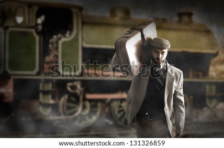 Emigrant man with the suitcases - stock photo