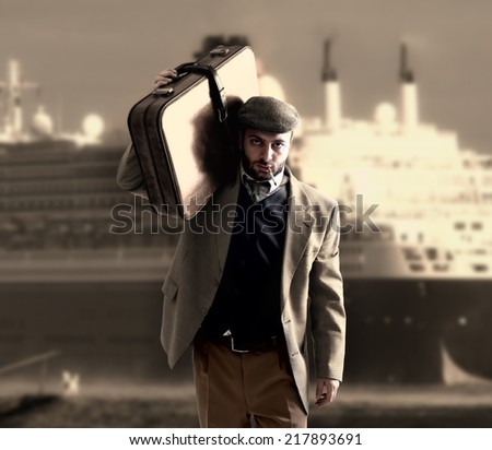 Emigrant man with the suitcases with a transatlantic ship behind - stock photo