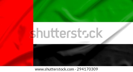emirates flag on soft and smooth silk texture - stock photo