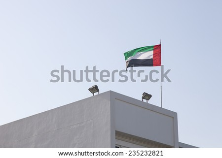 emirates flag on the top of roof - stock photo