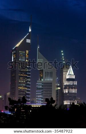 Emirates Towers at night - Sheikh Zayed road, Dubai, UAE - stock photo