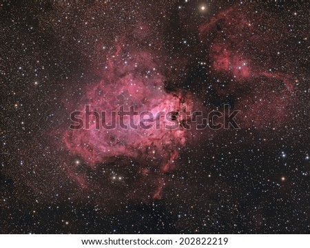 Emission Nebula Messier 17. This is a picture of emission nebula M17, also known as the Swan Nebula. It is about 6,000 light years away in the constellation Sagittarius.