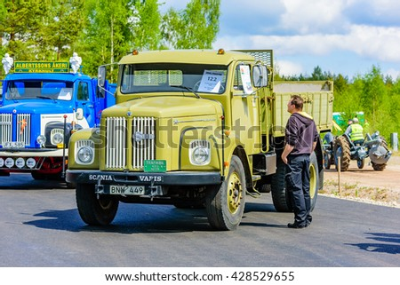 Emmaboda, Sweden - May 14, 2016: Forest and tractor (Skog och traktor) fair. Vintage classic trucks on parade. Here a green 1966 Scania Vabis L76 with flatbed.