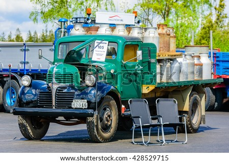 Emmaboda, Sweden - May 14, 2016: Forest and tractor (Skog och traktor) fair. Vintage classic trucks on parade. Here a green 1947 Plymouth Fargo with milk canisters on the flatbed. - stock photo