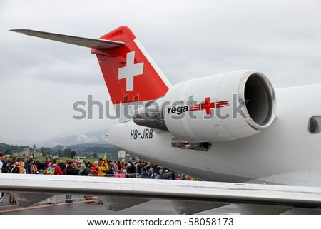 "EMMEN, SWITZERLAND - JULY 24: Swiss Air rescue REGA presents its long distance jet Canadair CL 604 Challenger open to walk in at the Airshow ""100 years Swiss aviation"" July 24, 2010 in Emmen, Switzerland."