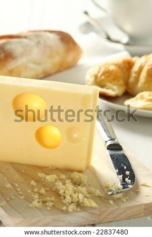 emmental cheese , grater, and croissant , preparing for cook.