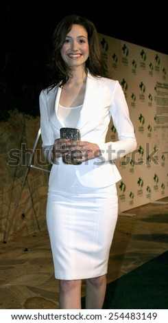 Emmy Rossum attends the Global Green Pre-Oscar Party held at the Day After Club in Hollywood, California on February 24, 2005.  - stock photo