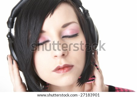 emo girl in head phones on white background - stock photo