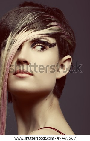 Emo girl with long blond fringe and cat eye make-up,  piercing on ear, lip - stock photo