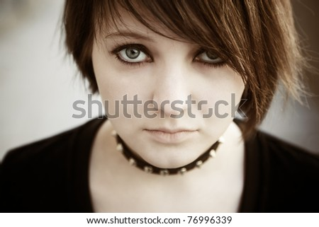 emo or goth young woman, natural soft light,selective focus on eye