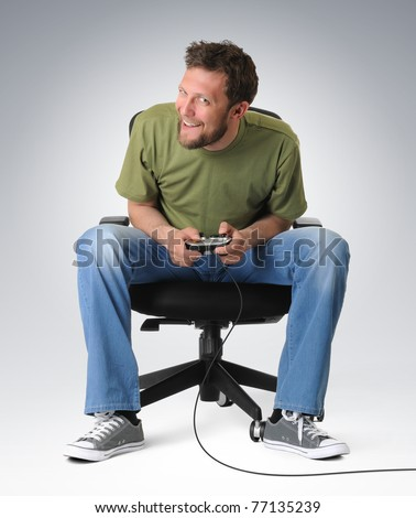 Emotion gamer to play on chair with joystick - stock photo