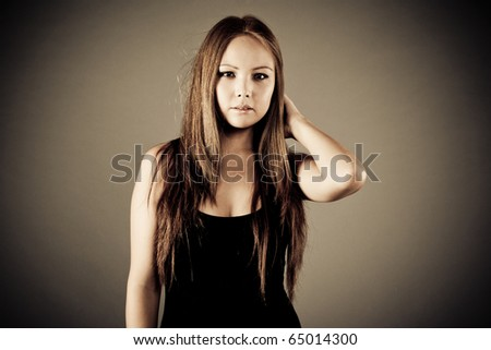 Emotion portrait asin girl on cretive background - stock photo