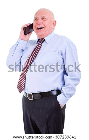 Emotional and happy old senior businessman in shirt and tie with white teeth. Talking on cell phone with an opened mouth. Isolated, plain white background. Human emotions and facial expressions