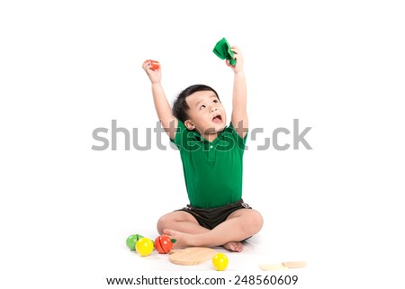 Emotional asian kid boy with his hands raised. Portrait of a active and confident baby boy showing thumbs up isolated one white - stock photo