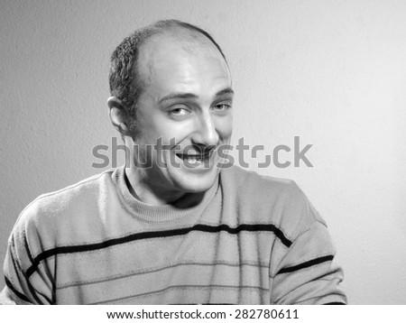 Emotional bald man. hilarious - stock photo