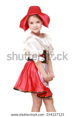 Emotional beautiful little girl dressed as fairy-tale characters in a red hat on a white background on Holiday/Caucasian little girl with a sweet smile in a beautiful dress and red hat