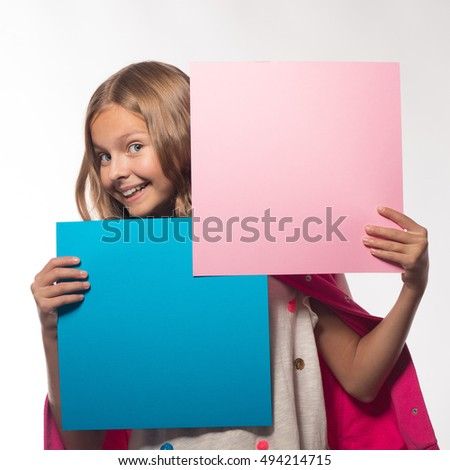 Emotional blonde girl in a pink jacket with a pink and blue sheet of paper for notes.