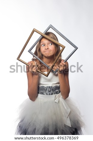 Emotional blonde girl in a white dress in a frame on a white background