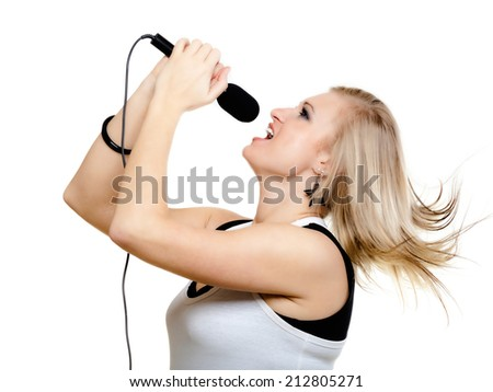 emotional blonde girl singer performer singing to microphone isolated on white. young pretty rockstar holding wireless mike - stock photo