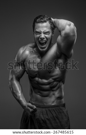Emotional bodybuilder. Black and white photo - stock photo