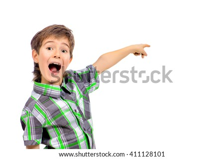 Emotional boy is pointing in the direction. Copy space. Education. Studio shot. Isolated over white. - stock photo