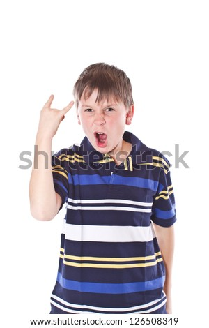emotional boy makes the sign of rock and roll on a white background - stock photo