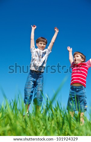 Emotional boys with their hands up - stock photo