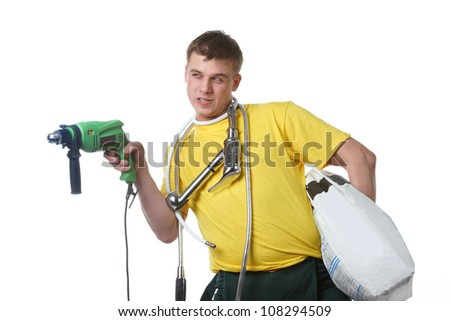 Emotional builder with a set of construction tools and materials - stock photo