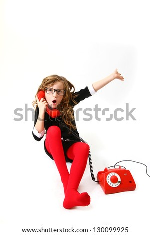 Emotional business little girl talking on the phone on a white background sitting - stock photo