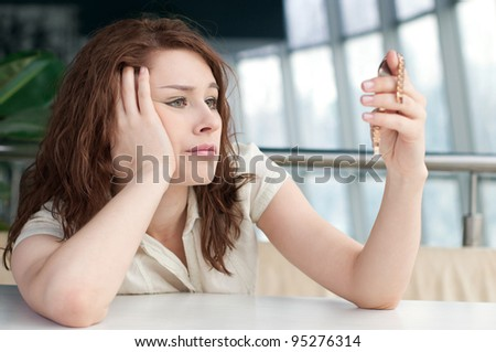 Emotional business woman with watch at office - stock photo