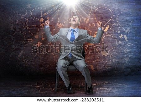 Emotional businessman sitting on chair and screaming above - stock photo