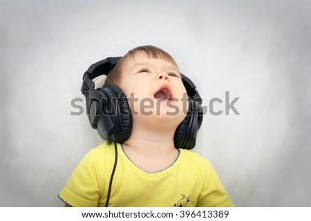 Emotional caucasian singing song  little girl having fun with headphones - stock photo