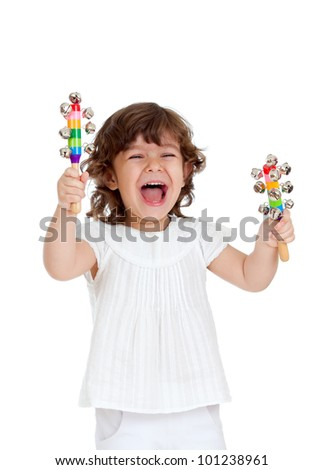 emotional child playing with musical toy - stock photo