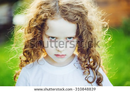 Emotional child with angry expression on face. - stock photo