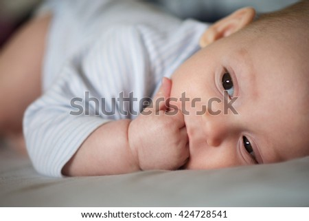 emotional close-up portrait of little baby boy with selective focus  - stock photo