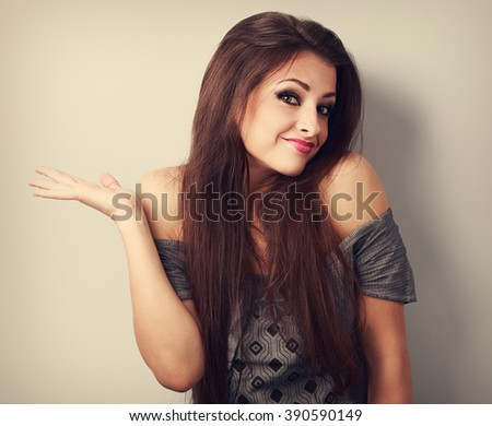 Emotional confused young fashion woman with long hair gesturing. Toned portrait - stock photo