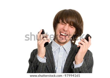 Emotional crying young stockbroker for two mobile phones. - stock photo