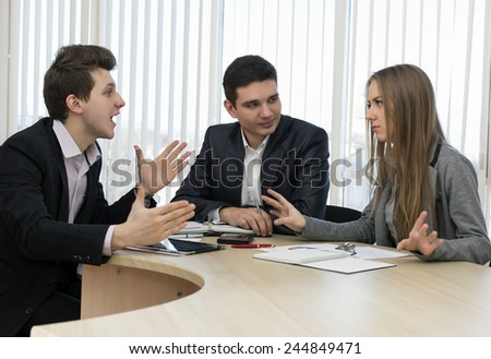 Emotional discussion. Business people shout out each other and makes aggressive gestures - stock photo