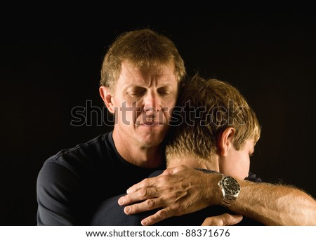 Emotional embrace, father and son - comforting, reconciliation, or just a tender hug