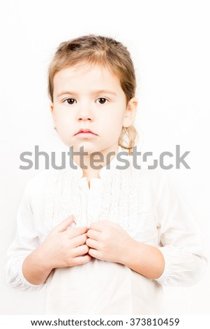Emotional facial Expression of little girl - calm - stock photo