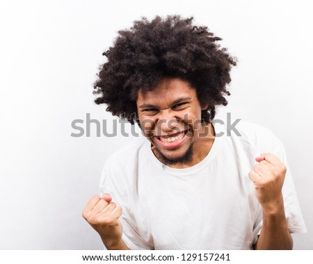 Emotional facial Expression of man - victory - stock photo