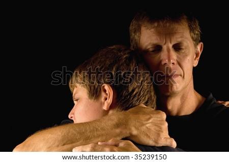 Emotional family hug, father crying - stock photo