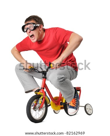 Emotional funny man on a children's bicycle isolated on white background - stock photo