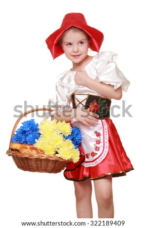 Emotional girl in a beautiful red dress and hat, holding a basket of cakes and chrysanthemums/Adorable happy little girl dressed as a red cap with a basket of pies on Holiday
