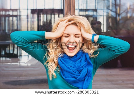Emotional girl outdoors - stock photo