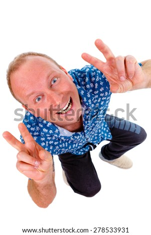 Emotional happy smiling man in blue shirt with white teeth showing two fingers on two hands, isolated on a white background - stock photo