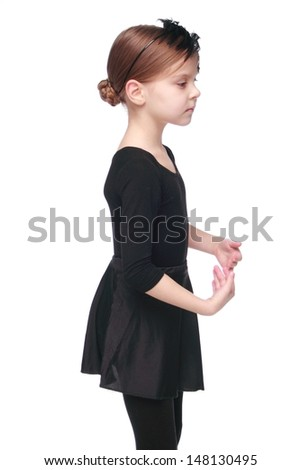 Emotional little ballerina in black tutu dancing  - stock photo