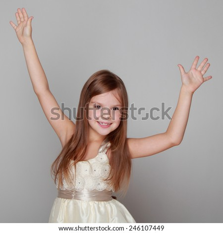emotional little girl in a beautiful dress is dancing - stock photo