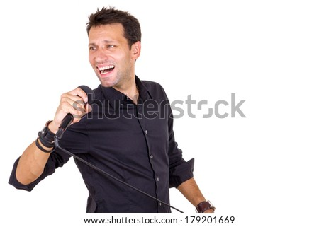 emotional male singer with microphone in hand - stock photo