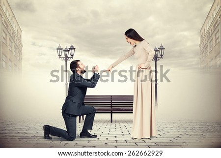 emotional man crying and looking at screaming woman. photo on foggy street - stock photo